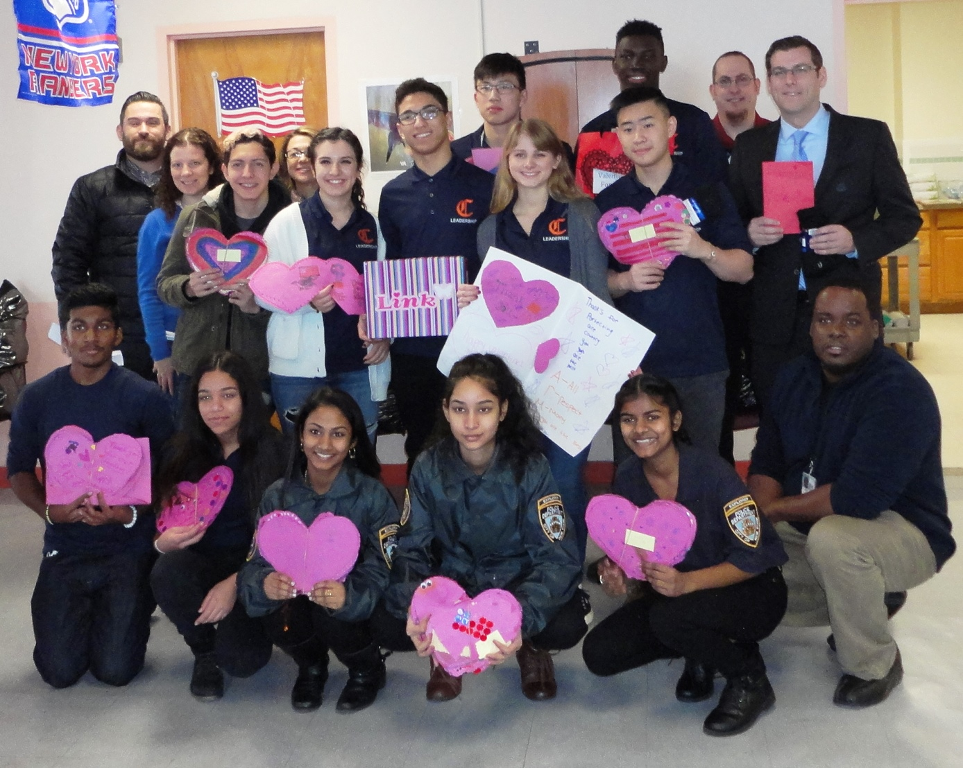 Assemblyman Braunstein, right, with students from Cardozo High School at the St. Albans Community Living Center