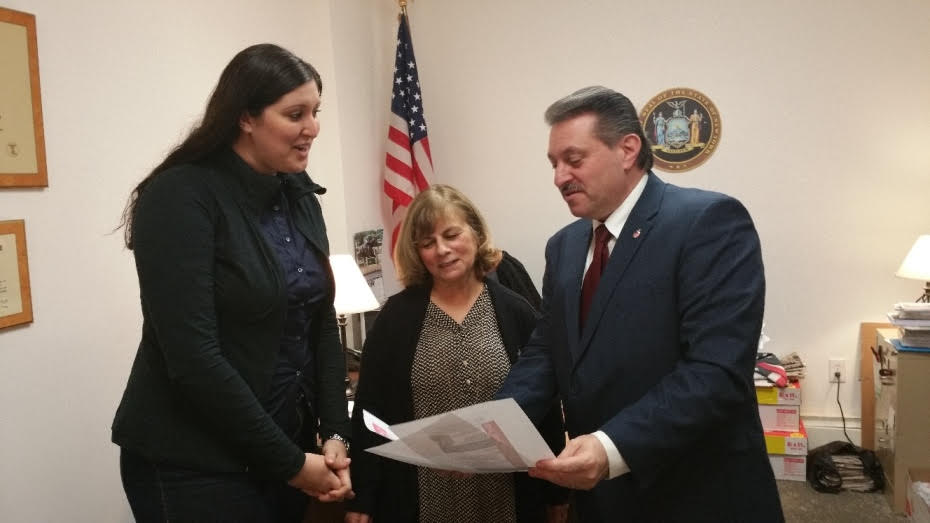State Senator Addabbo, right, spoke with two representatives from the Adelphi program.